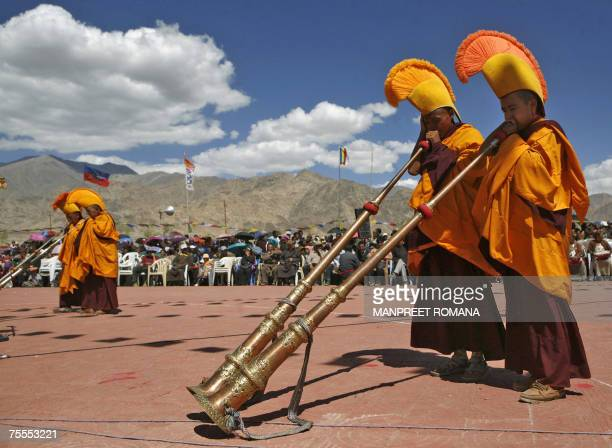 Buddhist nuns blow ceremonial trumpets as they perform a rarely performed religious dance called Nga Chham, outside The Naro Photang Puspahari temple...