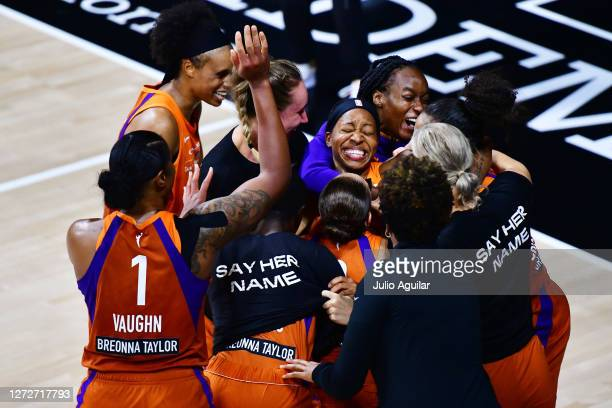 Shey Peddy of the Phoenix Mercury is surrounded by teammates after hitting a 3-point buzzer beater to defeat the Washington Mystics in Game One of...