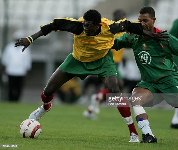 Sheyi Adebayor of Togo evades Jamal Alioui of Morocco during the International friendly match between Morocco and Togo at the Stade Diochon on August...