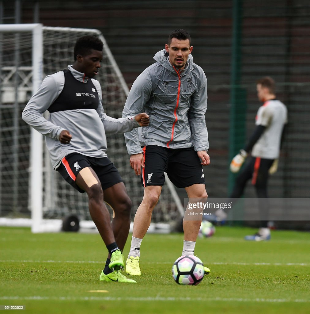 Sheyi Ojo and Dejan Lovren of Liverpool during a training session at Melwood Training Ground on March 17, 2017 in Liverpool, England.