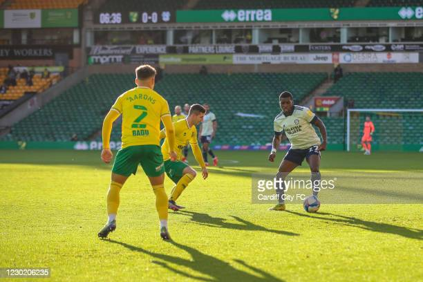 Sheyi Ojo of Cardiff City FC and Max Aarons of Norwich City during the Sky Bet Championship match between Norwich City and Cardiff City at Carrow...