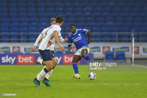 Sheyi Ojo of Cardiff City FC and Sonny Bradley of Luton Town during the Sky Bet Championship match between Cardiff City and Luton Town at Cardiff...