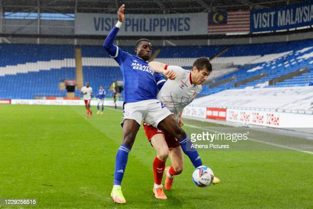 Sheyi Ojo of Cardiff City is challenged by Paddy McNair of Middlesbrough during the Sky Bet Championship match between Cardiff City and Middlesbrough...