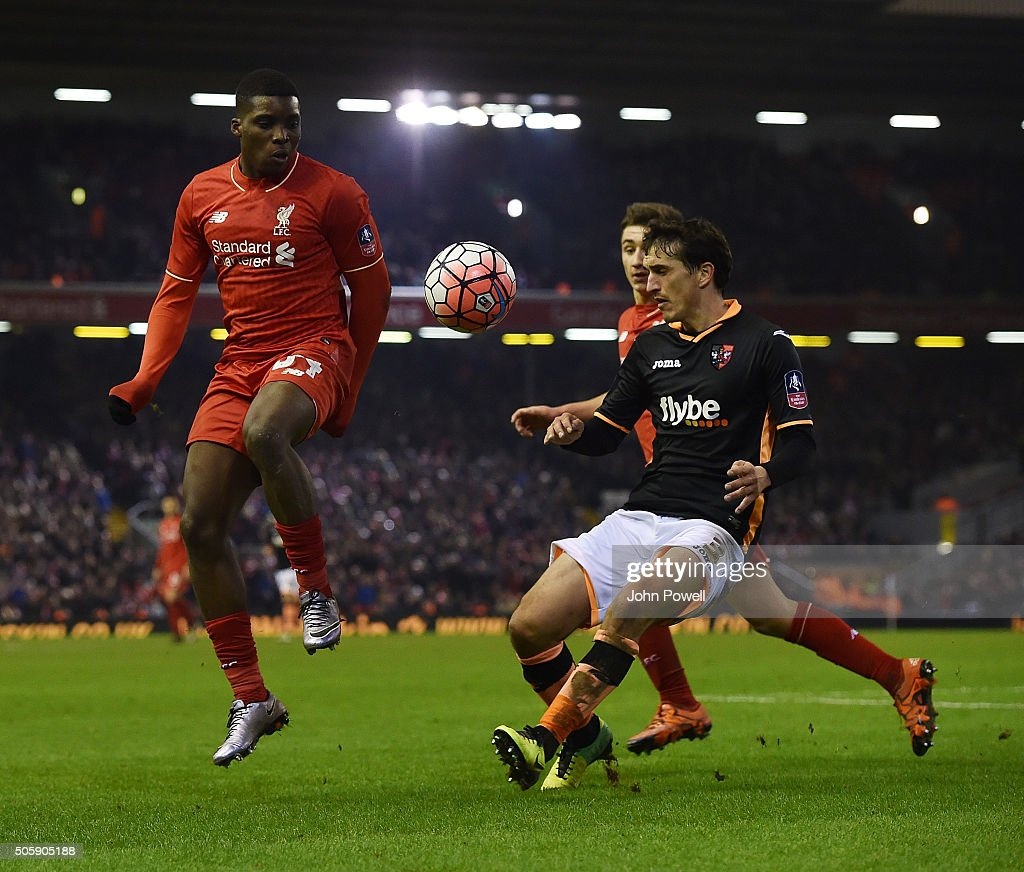 Sheyi Ojo of Liverpool competes with Craig Woodman of Exeter City during The Emirates FA Cup Third Round Replay between Liverpool and Exeter City at Anfield on January 20, 2016 in Liverpool, England.