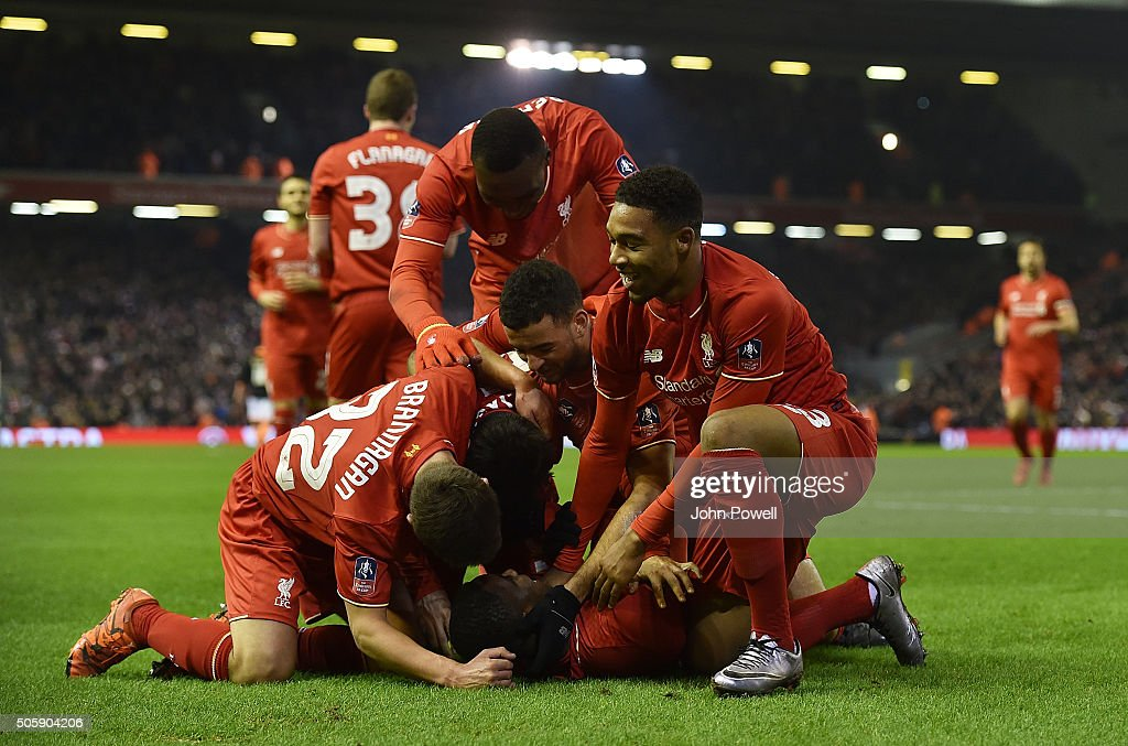 Sheyi Ojo of Liverpool is congratulated after his goal during The Emirates FA Cup Third Round Replay between Liverpool and Exeter City at Anfield on January 20, 2016 in Liverpool, England.