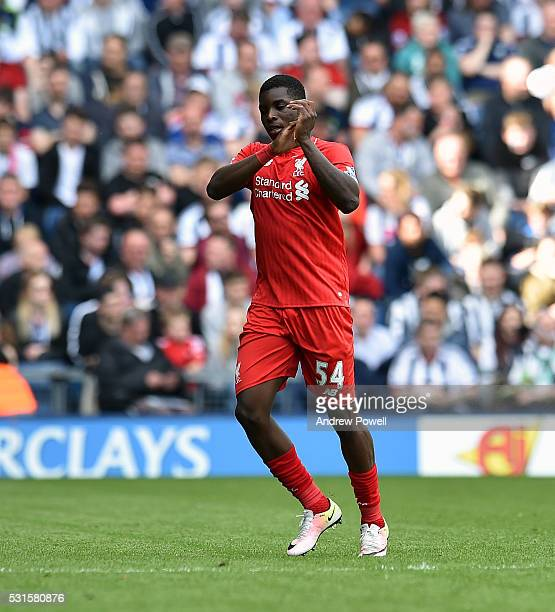 Sheyi Ojo of Liverpool shows his appreciation to the fans at the end of the Barclays Premier match between West Bromwich Albion and Liverpool at The...