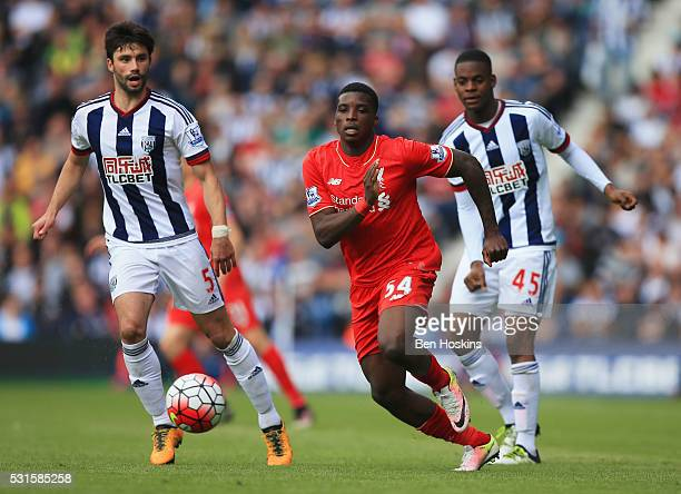 Sheyi Ojo of Liverpool takes on Claudio Yacob and Jonathan Leko of West Bromwich Albion during the Barclays Premier League match between West...