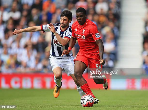 Sheyi Ojo of Liverpool takes on Claudio Yacob of West Bromwich Albion during the Barclays Premier League match between West Bromwich Albion and...