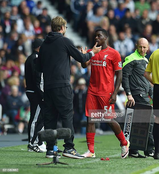 Sheyi Ojo of Liverpool with Jurgen Klopp manager of Liverpool during the Barclays Premier match between West Bromwich Albion and Liverpool at The...