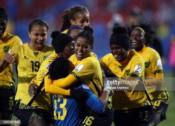 Sheyla Diaz celebrates her game winning goal with goalkeeper Onelys Alvarado of Jamaica during the CONCACAF Women's Championship third place match at...