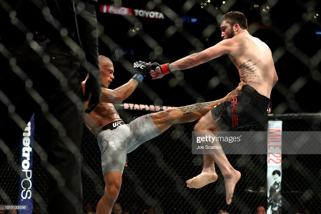Sheymon Moraes kicks Matt Sayles in the third round of the featherweight bout during UFC 227 at Staples Center on August 4, 2018 in Los Angeles, United States.
