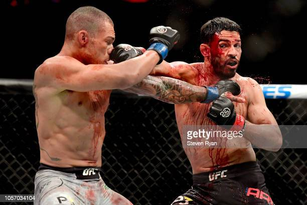 Sheymon Moraes of Brazil fights against Julio Arce of the United States in their featherweight bout during the UFC 230 event at Madison Square Garden...