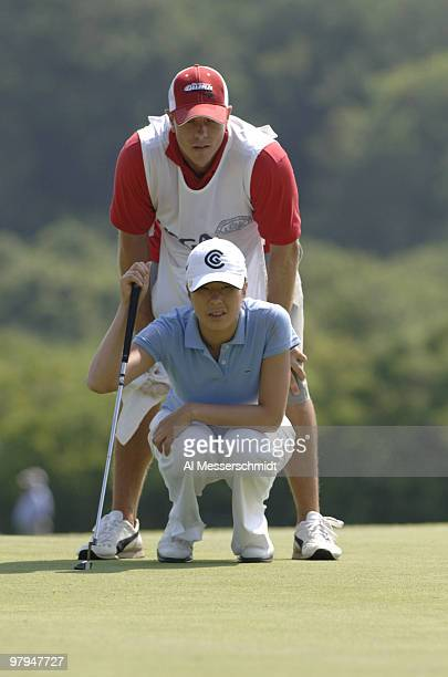 Shi Hyun Ahn lines up her putt on the 10th green during the second round of the 2006 US Women's Open at the Newport Country Club in Newport Rhode...