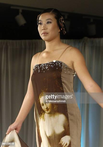 Shi Hyun Ahn models an Andre Kim gown on the fashion runway at the 2006 SBS Open at Turtle Bay February 14 at Kahuku Hawaii