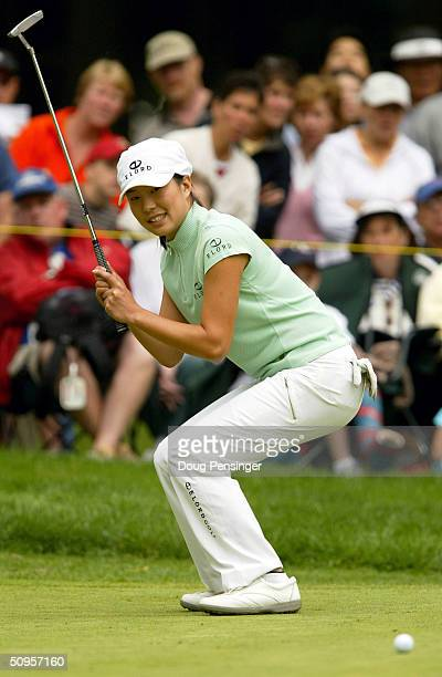 Shi Hyun Ahn of Inchon Korea reacts as she narrowly misses her birdie putt on the 17th hole during the final round of the McDonald's LPGA...