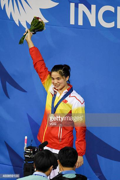 Shi Jinglin wins gold medal in the final of women's breaststroke 100 m during day two of the 2014 Asian Games at Munhak Park Tae-hwan Aquatics Center...