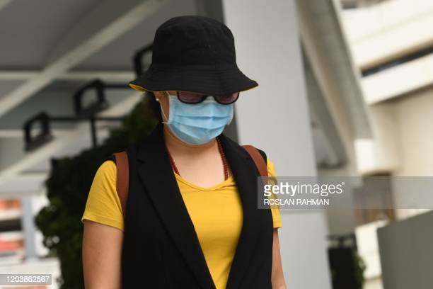 Shi Sha, a Chinese national residing in Singapore and her husband Hu Jun who is from Wuhan leaves the State court in Singapore on February 28, 2020....