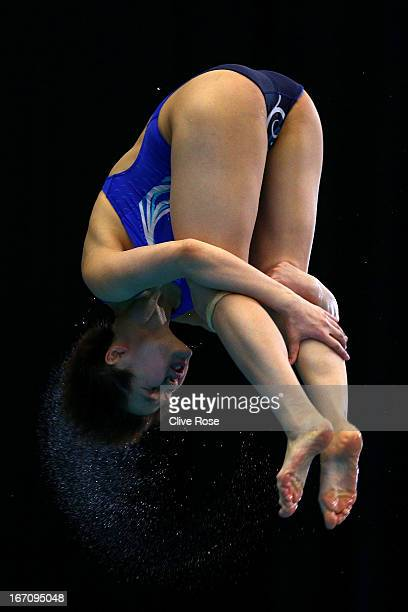 Shi Tingmao of China competes in the Women's 3m Springboard semi final during day two of the FINA/Midea Diving World Series 2013 at the Royal...