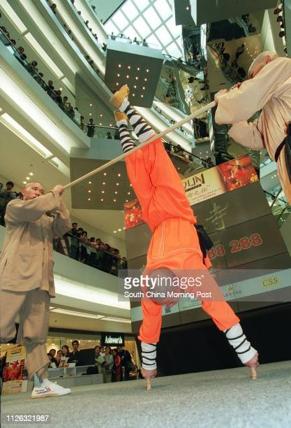 """Shi Yanbao one of the Shaolin monks who will perform in a stage production called """"Shaolin-Wheel of Life"""", shows his kung-fu techniques by standing..."""