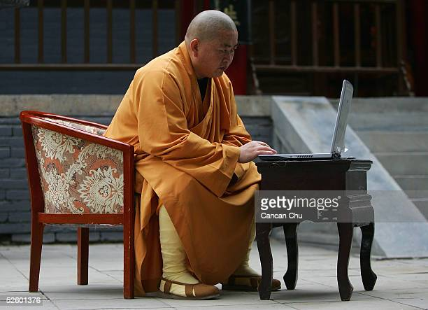 Shi Yongxin abbot of the Shaolin Temple works on the computer April 8 2005 in Dengfeng Henan Province China Shaolin Temple was built in AD 495 in the...