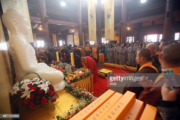 Shi Yongxin of Shaolin Temple presides over the 'Ten Thousand People Copy Confucian Classics' launching ceremony on Dragon Headsraising Day on March...