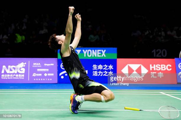 Shi Yuqi of China celebrates after defeating Chen Long of China in their Men's Singles Semifinals match during the Badminton World Championships at...