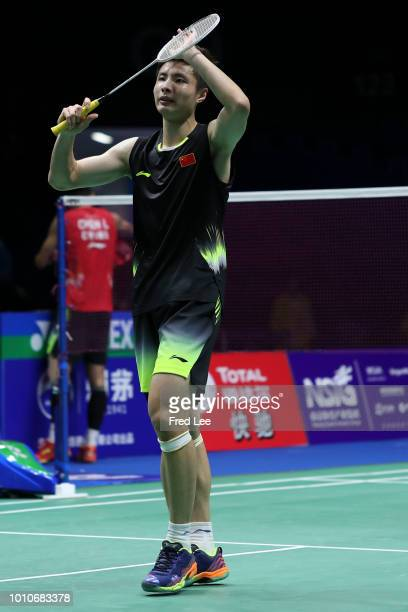 Shi Yuqi of China celebrates after defeating Chen Long of China in their Men's Singles Semifinals match during the Total BWF World Championships at...