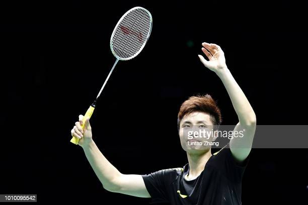 Shi Yuqi of China celebrates after defeating Chou Tien Chen of Chinese Taipei in their men's singles quarterfinals during the Badminton World...