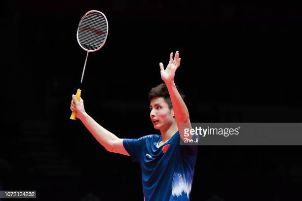 Shi Yuqi of China celebrates after defeating Son Wan Ho of Korea during the Men's Singles match on day 1 of the HSBC BWF World Tour Finals at Tianhe...