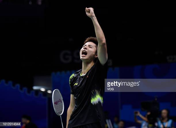 Shi Yuqi of China celebrates after winning the Men's Singles eighth-final match against Lin Dan of China on day four of TOTAL BWF World Championships...