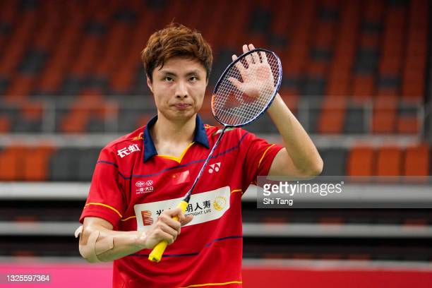 Shi Yuqi of China celebrates the victory in the China National Badminton Team Olympics simulated game in Men's Single match during day two on June...