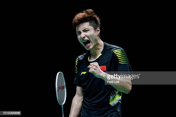 Shi Yuqi of China celebrates winning a point against Chou Tien Chen of Chinese Taipei in their Men's singles quarterfinals during the Total BWF World...