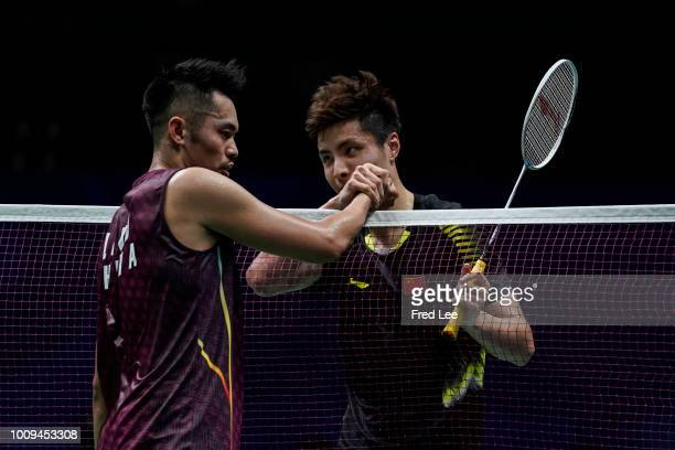 Shi Yuqi of China celebrates winning a point against Lin Dan of China in their Men's singles third round match during the Badminton World...