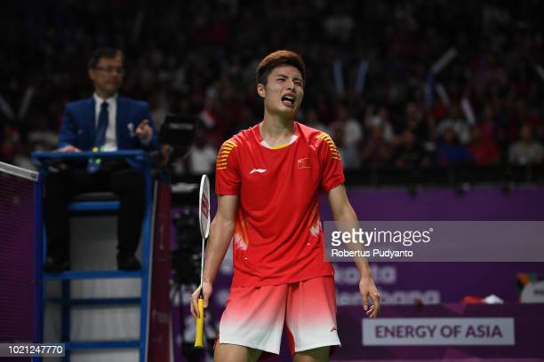Shi Yuqi of China competes against Anthony Sinisuka Ginting of Indonesia during Men's Team final match between Indonesia and China on day four of the...
