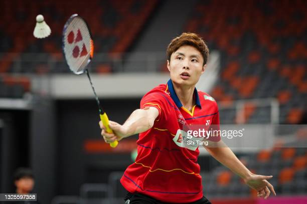Shi Yuqi of China competes in the China National Badminton Team Olympics simulated game in Men's Single match during day two on June 26, 2021 in...