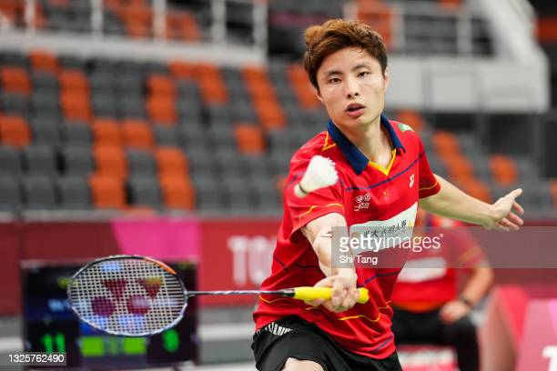 Shi Yuqi of China competes in the China National Badminton Team Olympics simulated game in Men's Single match against Chen Long of China during day...