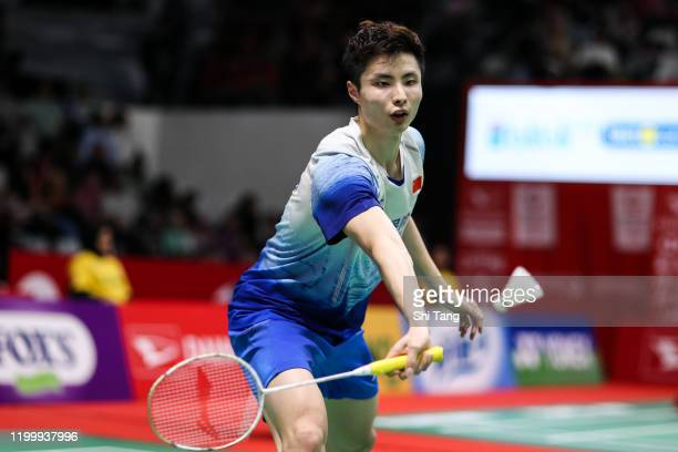Shi Yuqi of China competes in the Men's Singles second round match against Ng Ka Long Angus of Hong Kong on day three of the Daihatsu Indonesia...