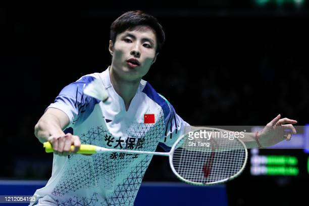 Shi Yuqi of China competes in the Men's Singles second round match against Zhao Junpeng of China on day two of the Yonex All England on March 12,...