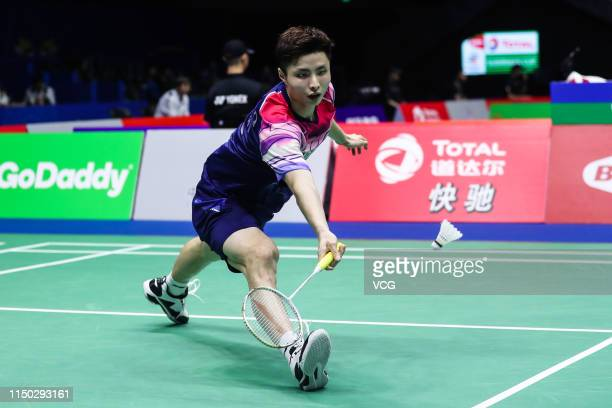 Shi Yuqi of China hits a return in the Men's Singles group match against Lee Zii Jia of Malaysia on day one of the Total BWF Sudirman Cup 2019 at...