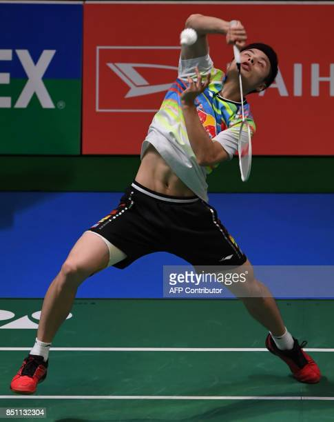 Shi Yuqi of China hits a return towards HS Prannoy of India during the men's singles quarterfinal match at the Japan Open Badminton Championships in...