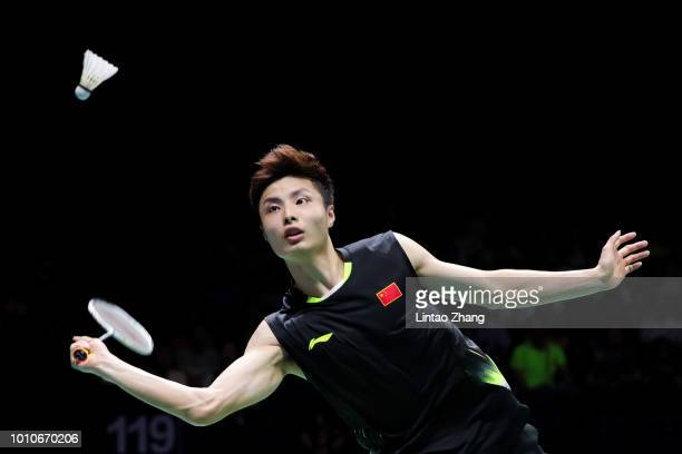 Shi Yuqi of China hits a shot against Chen Long of China in their Men's Singles Semifinals match during the Badminton World Championships at Nanjing...