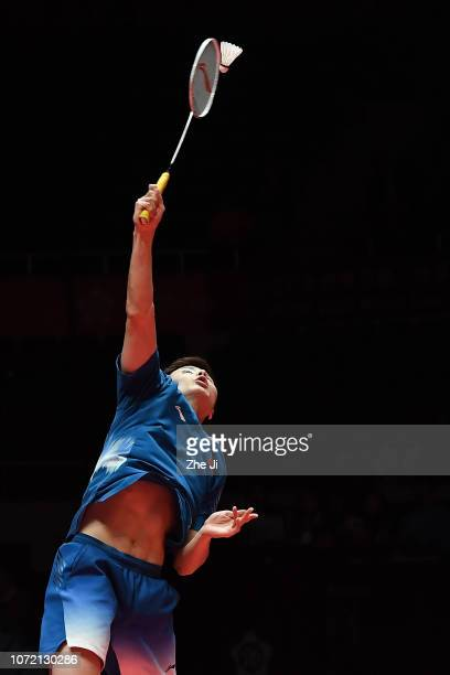 Shi Yuqi of China hits a shot against Son Wan Ho of Korea during the Men's Singles match on day 1 of the HSBC BWF World Tour Finals at Tianhe...