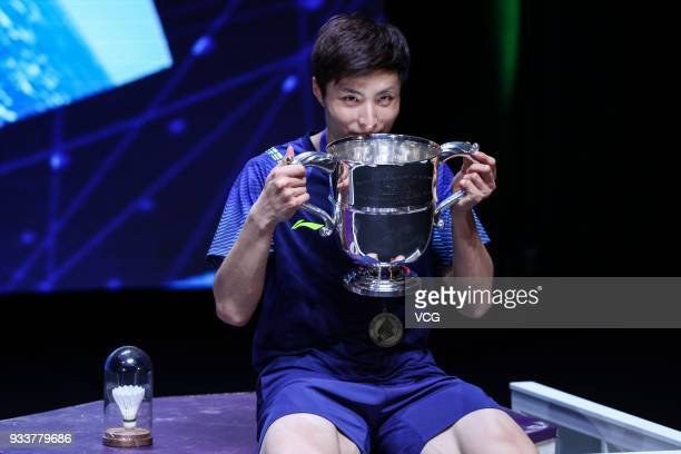 Shi Yuqi of China poses with his trophy after winning the Men's singles final match against Lin Dan of China on day five of the YONEX All England...