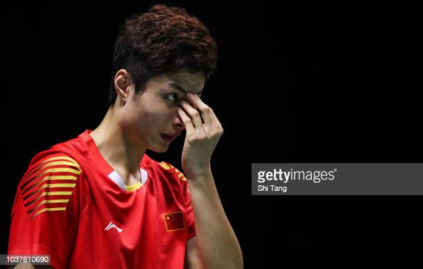 Shi Yuqi of China reacts after a point in the Men's Singles semi finals match against Kento Momota of Japan on day four of the China Open at Olympic...
