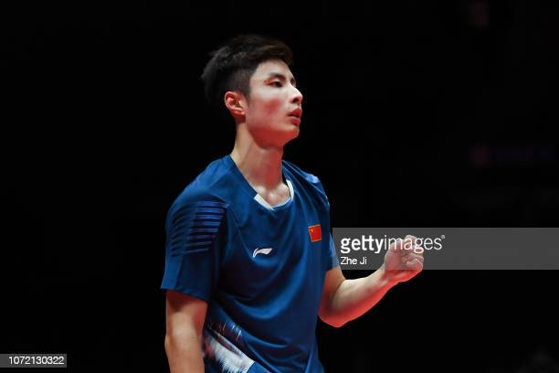 Shi Yuqi of China reacts in against Son Wan Ho of Korea during the Men's Singles match on day 1 of the HSBC BWF World Tour Finals at Tianhe Gymnasium...