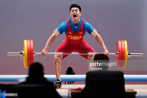 Shi Zhiyong of China competes in the men's 73kg weightlifting on day one of the Ready Steady Tokyo - Weightlifting, Tokyo 2020 Olympic Games test...