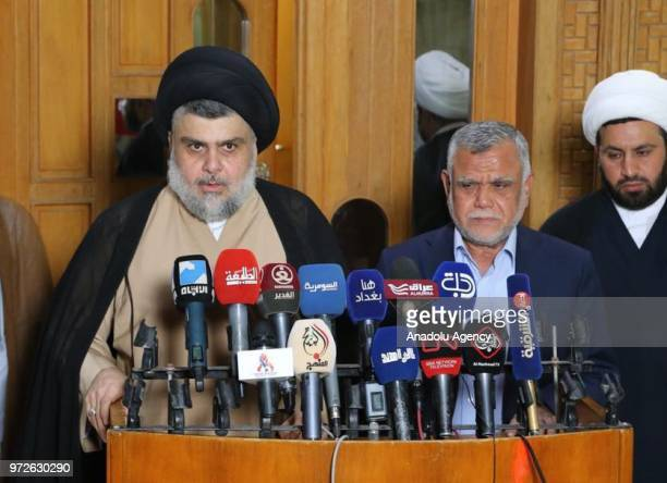 Shia cleric Muqtada alSadr speaks during a joint press conference held with the commander of the Popular Mobilization Forces and leader of Fatah's...