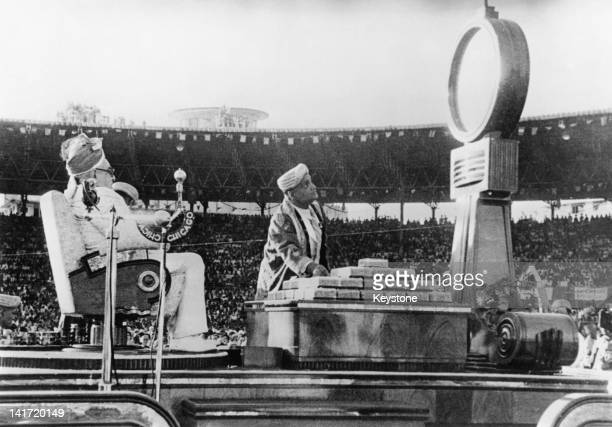 Shia Ismaili Muslim leader Aga Khan III measures his own weight in diamonds during his Diamond Jubilee at the Brabourne Stadium in Mumbai India March...