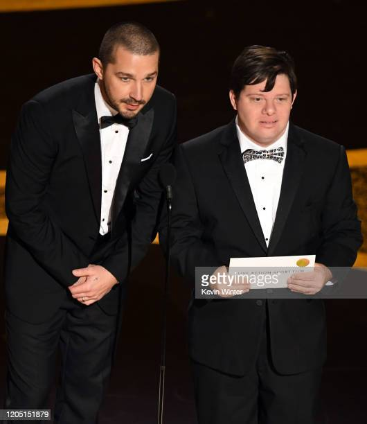 Shia LaBeouf and Zack Gottsagen speak onstage during the 92nd Annual Academy Awards at Dolby Theatre on February 09 2020 in Hollywood California