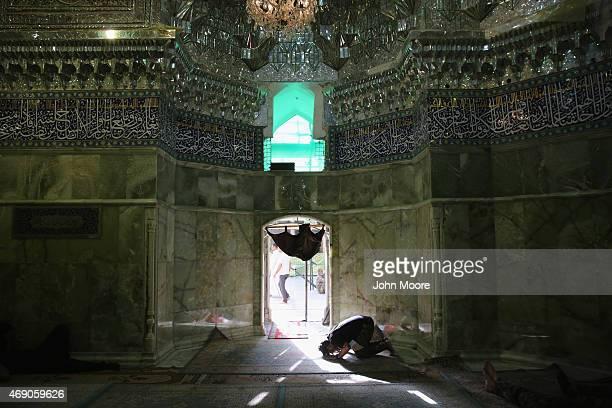 Shia militaman prays inside the al-Askari shrine on April 9, 2015 in Samarra, Iraq. The shrine, built in 944, was severely damaged in 2006-07...